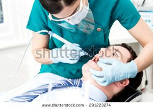 stock-photo-male-with-open-mouth-during-oral-checkup-at-dentist-291223274